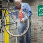 thumbnail slide for Man washing bike at washing station